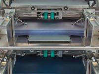 Dual Interposer Bins for Covers and Index Tabs